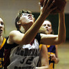 Globe/T. Rob Brown<br /> McDonald County's Amber Bratton (32) shoots for two against Monett during Wednesday afternoon action at the Neosho Holiday Classic, Dec. 27, 2006, at Neosho Middle School.<br /> Section: Sports