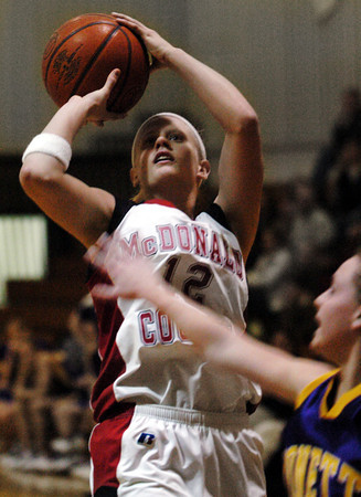 Globe/T. Rob Brown<br /> McDonald County's Melanie Bowers (12) shoots over a Monett defender during Wednesday afternoon action at the Neosho Holiday Classic, Dec. 27, 2006, at Neosho Middle School.<br /> Section: Sports