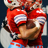 Globe/T. Rob Brown<br /> Webb City's Collin Howard gets congratulated by teammate (40) after scoring a touchdown during the Show Me Bowl in St. Louis Thursday afternoon, Nov. 24, 2006.<br /> Section: Sports
