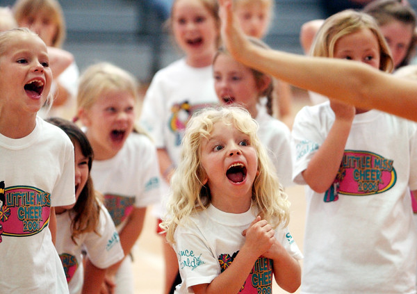 Globe/T. Rob Brown<br /> Ashley Koch of Joplin and other first graders yell  during the Little Miss Cheer Camp at Memorial Middle School in Joplin Monday evening, June 5, 2006.<br /> Section: News
