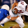 Globe/T. Rob Brown<br /> Joplin's (11) Mitchell Burr gets brought down by Rockhurst's (18) John Calhoun during Friday night's game, Oct. 20, 2006, at Rockhurst High School.<br /> Section: Sports