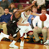 Globe/T. Rob Brown<br /> Joplin's Taylor Macfee (11) drives the ball past Central's Quinton Vann (24) during Tuesday night's game, Jan. 3, 2006, at Joplin High School.<br /> Section: Sports