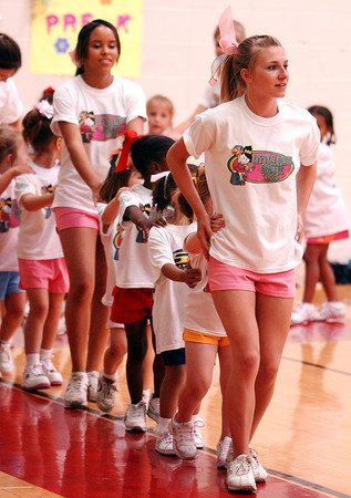 "Globe/T. Rob Brown<br /> Joplin High School varsity cheerleader Kendra Robinson, going to be a junior, leads a ""choo choo train"" of pre-kindergarten students to the water fountain during the Little Miss Cheer Camp at Memorial Middle School in Joplin Monday evening, June 5, 2006.<br /> Section: News"