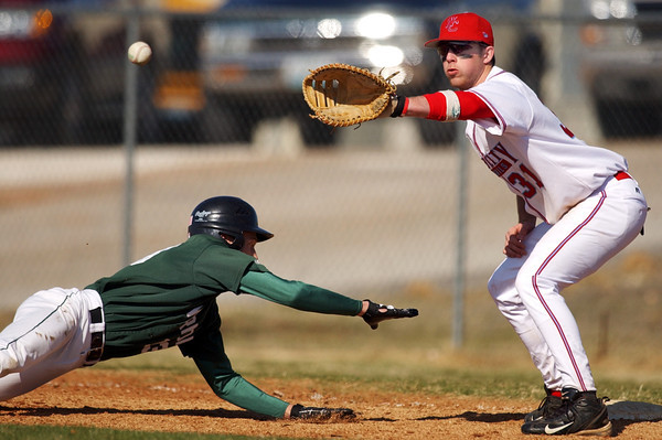 Globe/T. Rob Brown<br /> Webb City firstbaseman Jerick Swarens (31) waits for the throw as Mount Vernon's Kyler Wilson (13) leaps back during a pickoff attempt Friday afternoon, March 24, 2006, at Barnes Field in Webb City during the Webb City Lead Off Classic 2006. The runner was safe.<br /> Section: Sports Story: Ryan