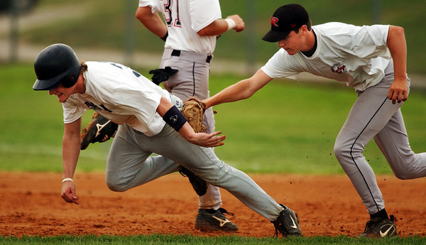 Globe/T. Rob Brown<br /> Joplin Sports Authority All-Stars' Jake Comer (39) gets tagged by St. Louis Rawlings Prospects White pitcher Nathan Smith (20) during the Premier Baseball World Series Thursday afternoon, July 27, 2006, at Joplin High School.<br /> Section: Sports