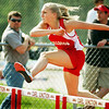 Globe/T. Rob Brown<br /> Carl Junction High School freshman Leneeah Morey competes in the 100-meter hurdles Monday afternoon, May 8, 2006, during the Big 8 Conference track meet at Carl Junction.