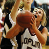 Globe/T. Rob Brown<br /> Joplin's Lindsay Altman (3) goes up for two against a Bentonville defender during Tuesday night's game, Dec. 19, 2006, at Joplin.<br /> Section: Sports