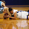 Globe/T. Rob Brown<br /> Riverton's Jon Wagner (23) and Southeast's Micah Holden (12) fight for a loose ball during Thursday night's game, Dec. 14, 2006, at Riverton (Kan.) High School.<br /> Section: Sports