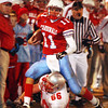 Globe/T. Rob Brown<br /> Webb City High School ball carrier quarterback Collin Howard (11) leaves Nixa High School defender Andy Schanfarber (66) in the dust as he maneuvers around the Nixa sideline during Monday night's competition, Nov. 13, 2006, at Webb City.<br /> Section: Sports