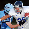 Globe/T. Rob Brown<br /> St. Mary's Colgan ballcarrier Austin Riggs (25) tries to avoid Southeast High School's Jamie Han (10) during Thursday night action, Aug. 31, 2006, at Southeast High School.<br /> Section: Sports