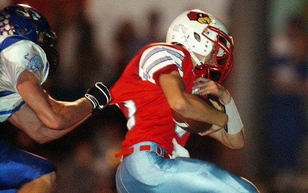 Globe/T. Rob Brown<br /> Webb City's Marcus Ozbun (17) tries to pull away from Carthage defender Clayton Norwood (48) during Wednesday night's game, Nov. 8, 2006, at Webb City.<br /> Section: Sports