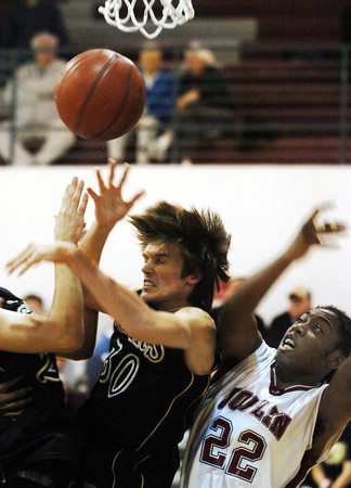 Globe/T. Rob Brown<br /> Joplin's Ja'cobe' Britt (22) and Bentonville's Harrison Snyder (30) fight for a rebound with other players during Tuesday night's game, Dec. 19, 2006, at Joplin.<br /> Section: Sports