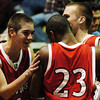 Globe/T. Rob Brown<br /> Carl Junction's Justin Gyznetson (10), left, congratulates Jordan Burton (23) along with an injured Paden Bennett (22), right, after the team's overtime victory over Francis Howell Central Wednesday afternoon during the Neosho Holiday Classic, Dec. 27, 2006, at Neosho High School.<br /> Section: Sports