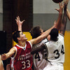 Globe/T. Rob Brown<br /> Carl Junction's Steven Tackett (33) fights for a rebound with Francis Howell Central's Pierre Desir (34) and another Francis Howell player Wednesday afternoon during the Neosho Holiday Classic, Dec. 27, 2006, at Neosho High School.<br /> Section: Sports