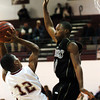 Globe/T. Rob Brown<br /> Joplin's Je'von Hackett (12) shoots for two over a Bentonville defender Patrick Hester (10) during Tuesday night's game, Dec. 19, 2006, at Joplin.<br /> Section: Sports
