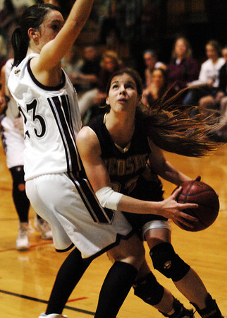Globe/T. Rob Brown<br /> Neosho's Lorelei Snow (33) starts to go up for two against Siloam Springs' Sarah Allison (23) during Friday night action, Dec. 29, 2006, at the Neosho Holiday Classic at Neosho Middle School.<br /> Section: Sports