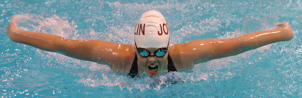 Globe/T. Rob Brown<br /> Joplin's Nickki Burkett performs in the 100-meter butterfly during Friday afternoon's swim meet at Missouri Southern State University, Dec. 15, 2006.<br /> Section: Sports
