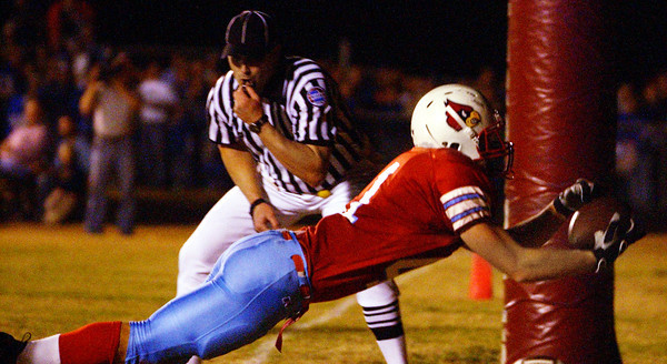 Globe/T. Rob Brown<br /> A referee keeps a close eye as Webb City's Jake Cockrell (41) scores on a two-point conversion against Carthage during Wednesday night's game, Nov. 8, 2006, at Webb City.<br /> Section: Sports