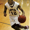 Globe/T. Rob Brown<br /> Joplin's Ja'von Hackett works his way to the basket against McDonald County during Tuesday night's game, Nov. 28, 2006, during a tournament at Carthage High School.<br /> Section: Sports