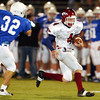 Globe/T. Rob Brown<br /> Joplin's (4) Cory Rector works to evade Rockhurst's (32) Billy Linscott during Friday night's game, Oct. 20, 2006, at Rockhurst High School.<br /> Section: Sports