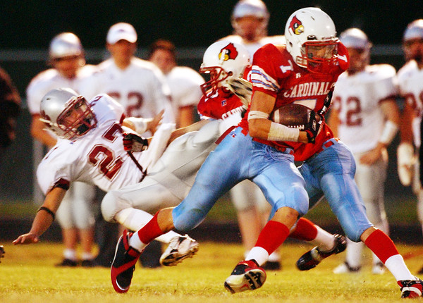 Globe/T. Rob Brown<br /> Webb City High School ballcarrier Landon Zerkel (7) takes off ahead of Nevada's defense including Aaron Dade (27) during Friday night's game, Sept. 29, 2006, at Webb City.<br /> Section: Sports