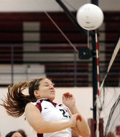 Globe/T. Rob Brown<br /> Joplin's Jessica Hill (23) reacts to the ball bouncing back off the net at her during Monday night's game, Oct. 23, 2006, against Parkview at Joplin.<br /> Section: Sports