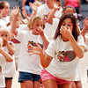 Globe/T. Rob Brown<br /> Joplin High School varsity cheerleader Megan Emrich, going to be a senior, leads a surfing-style cheer during the Little Miss Cheer Camp at Memorial Middle School in Joplin Monday evening, June 5, 2006.<br /> Section: News
