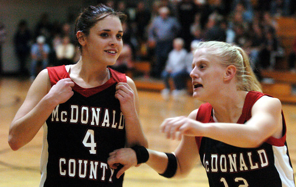 Globe/T. Rob Brown<br /> McDonald County teammates Layne Walters (4) and Melanie Bowers (12) share a moment following their one-point victory over Pierce City during Thursday night action, Dec. 28, 2006, during the Neosho Holiday Classic at Neosho Middle School.<br /> Section: Sports