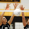 Globe/T. Rob Brown<br /> College Heights Christian School's Leia Pittman (7) (left) and Brittany Eppright (10) block a Southwest kill attempt during the Class 2 District 12 Volleyball Tournament Tuesday night, Oct. 24, 2006, at Diamond High School.<br /> Section: Sports
