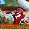 Globe/T. Rob Brown<br /> Joplin runner Chris Black (27) gets hit by a throw from the Nixa catcher after it went past Nixa first baseman Tyler Patterson (22) during a pickoff attempt Tuesday evening, March 28, 2006, at Joplin High School.