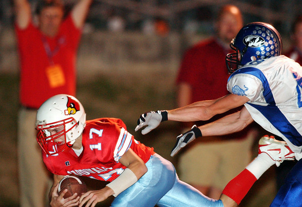 Globe/T. Rob Brown<br /> Webb City's Marcus Ozbun (17) brings down a pass ahead of Carthage's Clayton Norwood (48) during Wednesday night's game, Nov. 8, 2006, at Webb City.<br /> Section: Sports