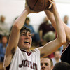 Globe/T. Rob Brown<br /> Joplin's Taylor Macfee shoots for two against McDonald County's defense during Tuesday night's game, Nov. 28, 2006, during a tournament at Carthage High School.<br /> Section: Sports
