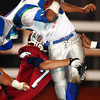 Globe/T. Rob Brown<br /> Joplin High School's Logan Simon (7) brings down South Blue Springs ball carrier Shane Simpson (25) during Friday night's game, Oct. 27, 2006, at Junge Stadium.<br /> Section: Sports