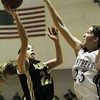 Globe/T. Rob Brown<br /> Neosho's Savannah Snow (23) goes up for two against Siloam Springs' Sarah Allison (23) during Friday night action, Dec. 29, 2006, at the Neosho Holiday Classic at Neosho Middle School.<br /> Section: Sports