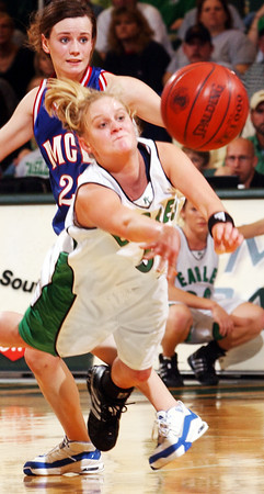 Globe/T. Rob Brown<br /> Pierce City's Jody Lathem (5) passes the ball as she gets tripped up by Marion C. Early defenders Rachelle Wilkins (not pictured) and Shelby Skinner (20) during Wednesday night's Missouri Class 2 Sectional game, March 8, 2006, at Missouri Southern State University's Leggett & Platt Athletic Center in Joplin.<br /> Section: Sports Story: Anvil Welch