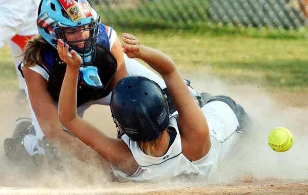 Globe/T. Rob Brown<br /> Joplin High School's Miranda Johnson scores a run against the Hillcrest High School catcher in Monday afternoon's game, Sept. 11, 2006, at Joplin's softball field.