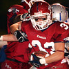 Globe/T. Rob Brown<br /> Joplin High School's Cody Kitts (33) gets brought down from behind by a South Blue Springs player after Kitts intercepted the ball during Friday night's game, Oct. 27, 2006, at Junge Stadium.<br /> Section: Sports