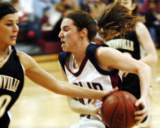 Globe/T. Rob Brown<br /> Joplin's Jessica Baker (21) gets fouled,  while attempting a shot, by Bentonville's Grace Campbell (20) during Tuesday night's game, Dec. 19, 2006, at Joplin.<br /> Section: Sports