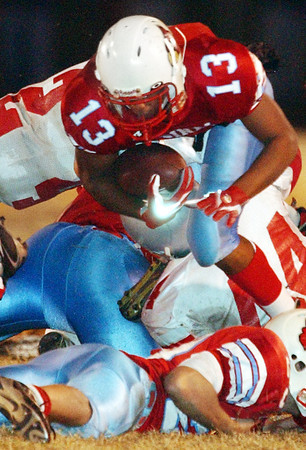 Globe/T. Rob Brown<br /> Webb City High School ball carrier Mack Kyle (13) leaps over Nixa High School defenders and his own teammates to reach the first down against Nixa during Monday night's competition, Nov. 13, 2006, at Webb City.<br /> Section: Sports