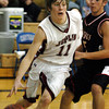 Globe/T. Rob Brown<br /> Joplin's Taylor Macfee works his way around McDonald County defender Bo Bergen during Tuesday night's game, Nov. 28, 2006, during a tournament at Carthage High School.<br /> Section: Sports