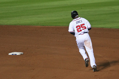 Andruw Jones rounds the bases to score his home run hit.