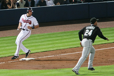 Mark Teixeira turns as he rounds third to see where Andruw Jones' hit landed.
