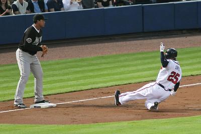 Andruw Jones steals third base.