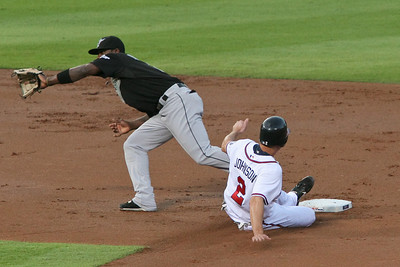 Kelly Johnson slides safely into second.