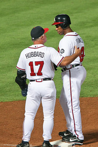 Coach Hubbard gives Julio Franco a pat on the back following his base hit.