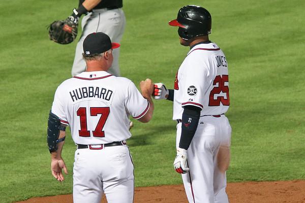 Coach Hubbard congratulates Andruw Jones on his hit.