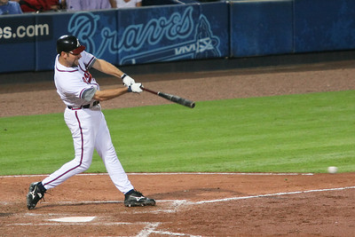 Pitcher John Smoltz gets a hit.