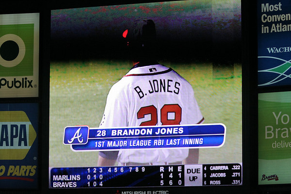Brandon Jones' first major league RBI is acknowledged on the video screen.
