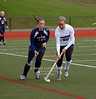 Brae Dowling (#20) taking the ball up the right side of the field, past Penn Manor's Nicole Henderson (#18)