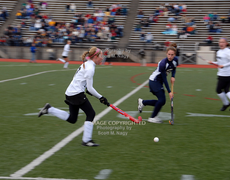 Allison Evans take the ball up the field.